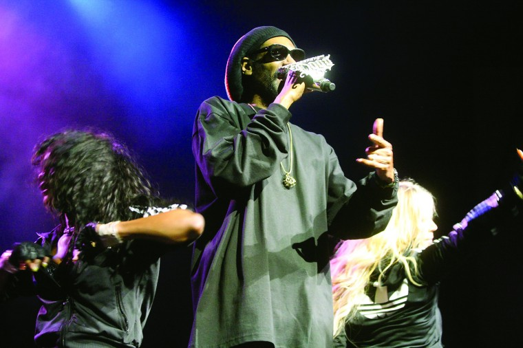 Snoop Dogg, aka Snoop Lion, performed at Constellation Brands-Marvin Sands Performing Arts Center Thursday night. Here, he sings with two of his backup dancers nearby. - Photo by Spencer Tulis/Finger Lakes Times